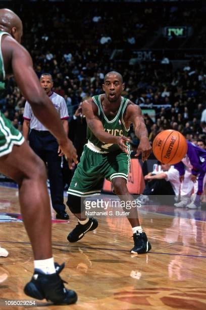 Kenny Anderson of the Boston Celtics passes the ball against the Toronto Raptors on November 2 1999 at the Air Canada Centre in Toronto Canada NOTE...