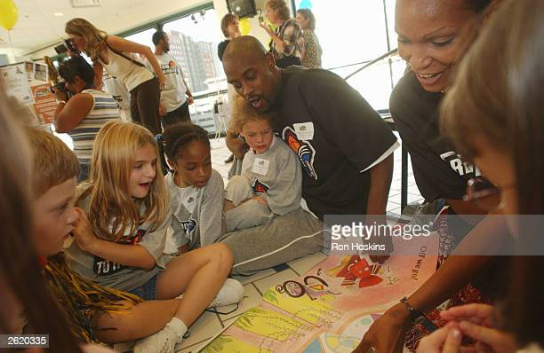 Kenny Anderson of the Indiana Pacers and Olympia ScottRichardson of the Indiana Fever read to area school kids during the third annual Read to...