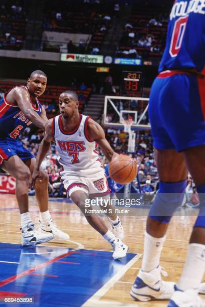 Kenny Anderson of the New Jersey Nets dribbles against the Detroit Pistons during a game played circa 1993 at the Brendan Byrne Arena in East...