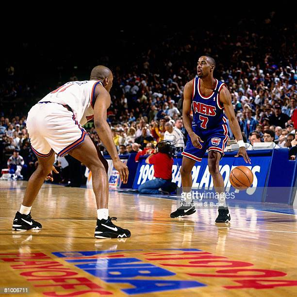 Kenny Anderson of the New Jersey Nets looks to make a move against Derek Harper of the New York Knicks in Game Two of the Eastern Conference...