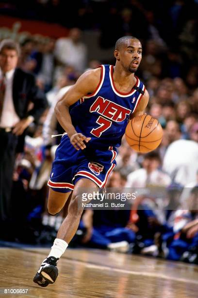 Kenny Anderson of the New Jersey Nets moves the ball up court in Game One of the Eastern Conference Quarterfinals against the New York Knicks during...