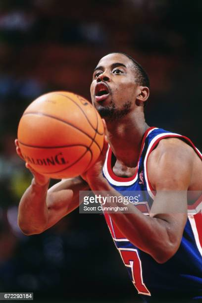 Kenny Anderson of the New Jersey Nets shoots a foul shot against the Atlanta Hawks during a game played circa 1990 at the Omni in Atlanta Georgia...