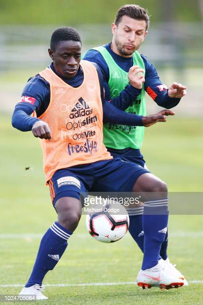 Kenny Athiu is tackled by Kosta Barbarouses during a Melbourne Victory training session at Gosch's Paddock on August 28, 2018 in Melbourne, Australia.