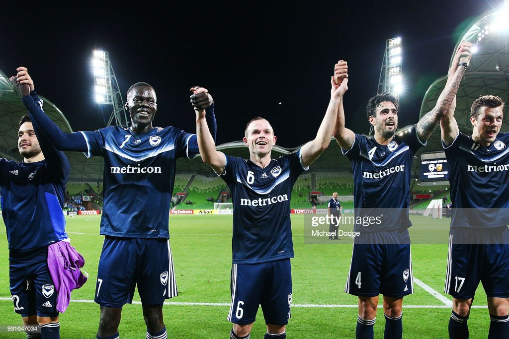 Kenny Athiu (L) Leigh Broxham (C) and Rhys Williams of the Victory celebrates the win during the AFC Asian Champions League match between the Melbourne Victory and Kawasaki Frontale at AAMI Park on March 13, 2018 in Melbourne, Australia.