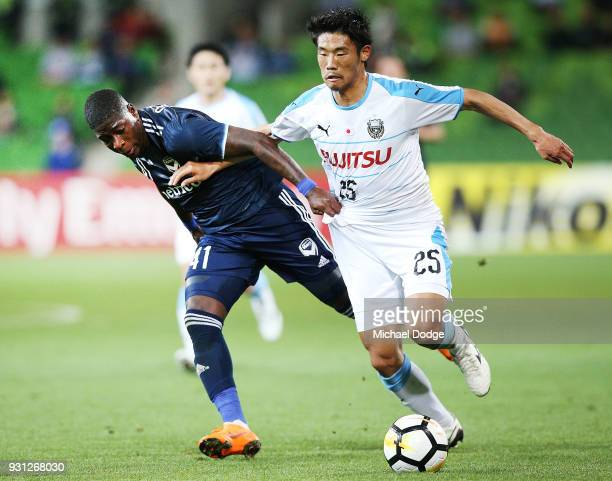 Kenny Athiu of the Victory is tackled by Hidemasa Morita of Kawasaki Frontale during the AFC Asian Champions League match between the Melbourne...