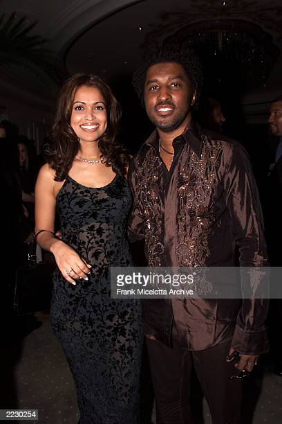 Kenny Baby Face Edmonds and his wife pose together at the 12th Annual Clive Davis PreGrammy party at the Beverly Hills Hotel in Los Angeles CA on...