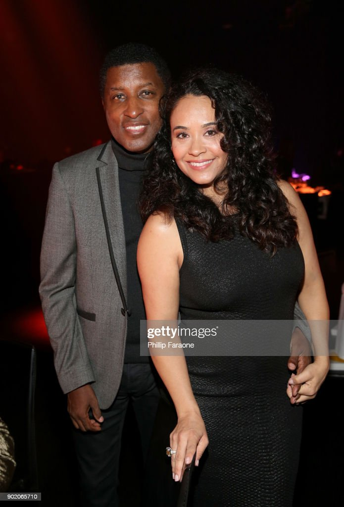 Kenny 'Babyface' Edmonds (L) and Nicole Pantenburg attend The Art Of Elysium's 11th Annual Celebration with John Legend at Barker Hangar on January 6, 2018 in Santa Monica, California.