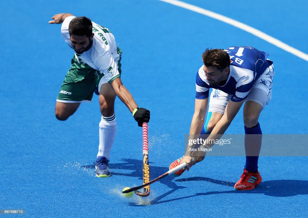 Kenny Bain of Scotland and Abu Mahmood of Pakistan battle for possession during the Pool B match between Scotland and Pakistan on day five of Hero Hockey World League Semi-Final at Lee Valley Hockey and Tennis Centre on June 19, 2017 in London, England.