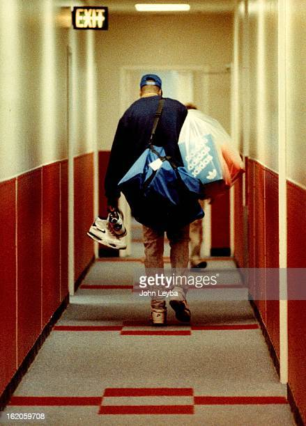 4241991 Kenny Battle walks down hallway with a bag over his shoulder after ***** and at McNichols arena