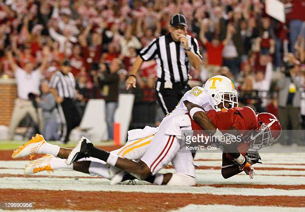 Kenny Bell of the Alabama Crimson Tide pulls in this touchdown reception against Prentiss Waggner of the Tennessee Volunteers at Bryant-Denny Stadium...