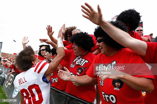 Kenny Bell of the Nebraska Cornhuskers celebrates with fans wearing afro wigs following the game against the Purdue Boilermakers at RossAde Stadium...