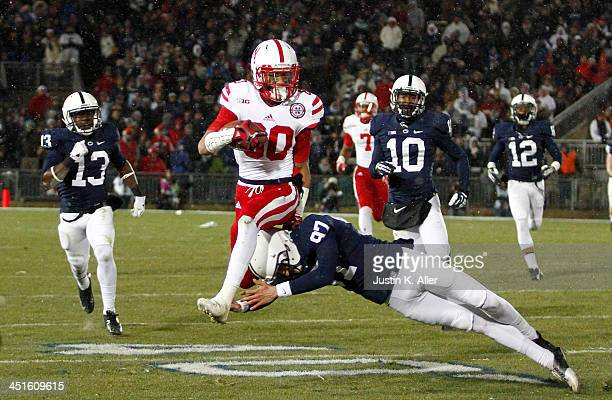 Kenny Bell of the Nebraska Cornhuskers runs back a kick off 99 yards for a touchdown against the Penn State Nittany Lions during the game on November...