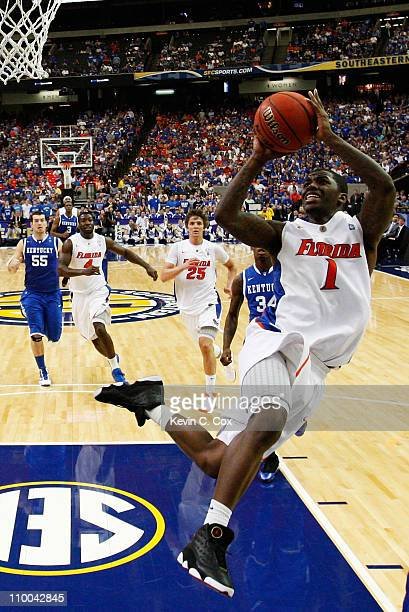 Kenny Boynton of the Florida Gators shoots against the Kentucky Wildcats in the championship game of the SEC Men's Basketball Tournament at Georgia...
