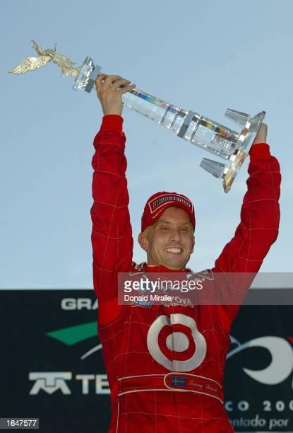 Kenny Brack celebrates winning the Gran Premio GiganteTelmex round 19 of the CART Fed Ex Championship Series on November 17 2002 at the Autodromo...