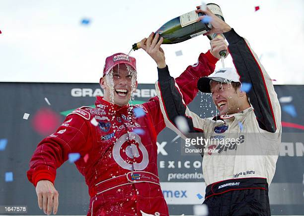 Kenny Brack celebrates winning with second placed Cristiano da Matta at the Gran Premio GiganteTelmex round 19 of the CART Fed Ex Championship Series...