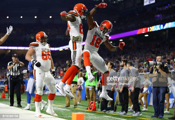 Kenny Britt of the Cleveland Browns celebrates his touchdown with teammates Ricardo Louis of the Cleveland Browns and Spencer Drango against the...
