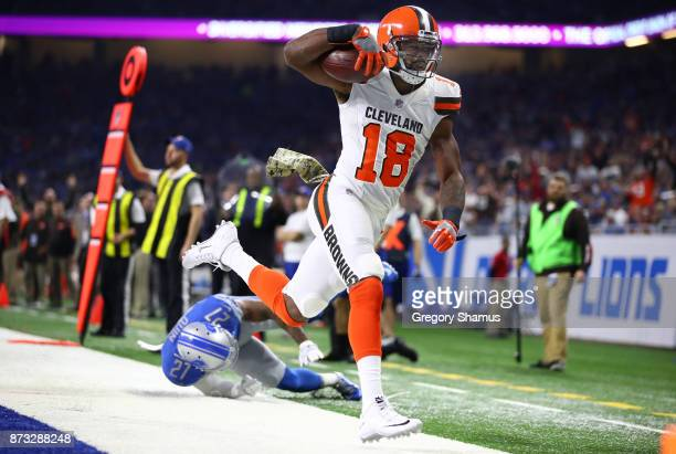 Kenny Britt of the Cleveland Browns scores a touchdown against Glover Quin of the Detroit Lions during the first quarter at Ford Field on November 12...