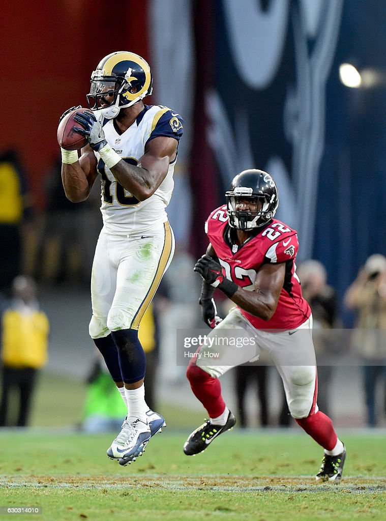 Kenny Britt #18 of the Los Angeles Rams makes a catch in front of Keanu Neal #22 of the Atlanta Falcons at Los Angeles Memorial Coliseum on December 11, 2016 in Los Angeles, California.