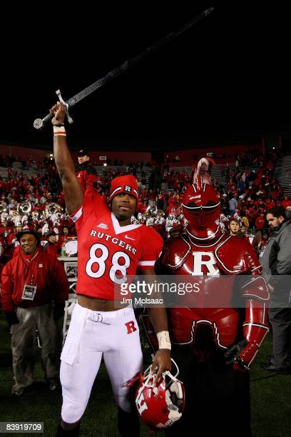 Kenny Britt of the Rutgers Scarlet Knights celebrates victory over the Louisville Cardinals at Rutgers Stadium on December 4, 2008 in Piscataway, New...