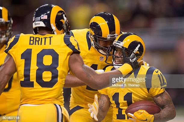 Kenny Britt of the St Louis Rams congratulates Tavon Austin after Austin scored a touchdown in the first quarter against the Tampa Bay Buccaneers at...