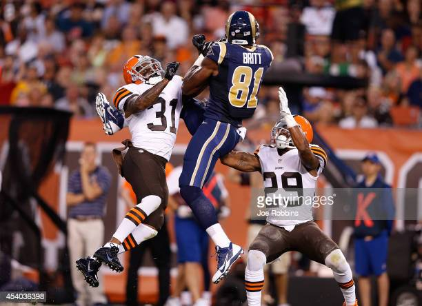 Kenny Britt of the St Louis Rams makes a catch between the defense of Donte Whitner of the Cleveland Browns and Leon McFadden of the Cleveland Browns...