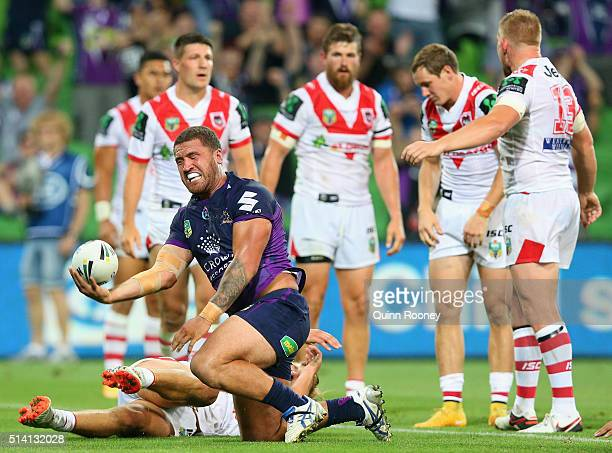 Kenny Bromwich of the Storm celebrates after scoring a try during the round one NRL match between the Melbourne Storm and the St George Illawarra...