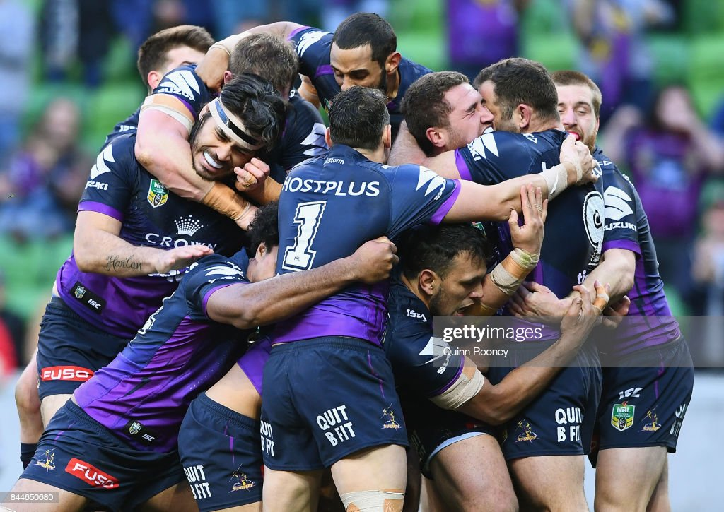 Kenny Bromwich of the Storm is congratulated by team mates after scoring a try during the NRL Qualifying Final match between the Melbourne Storm and the Parramatta Eels at AAMI Park on September 9, 2017 in Melbourne, Australia.