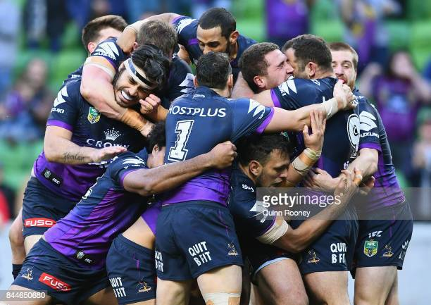 Kenny Bromwich of the Storm is congratulated by team mates after scoring a try during the NRL Qualifying Final match between the Melbourne Storm and...