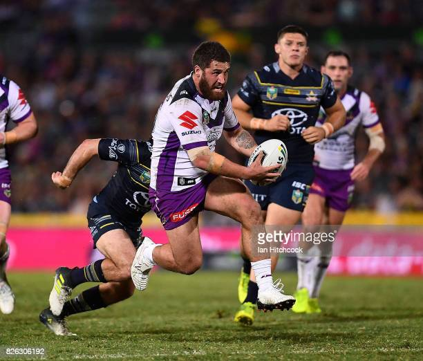 Kenny Bromwich of the Storm makes a break during the round 22 NRL match between the North Queensland Cowboys and the Melbourne Storm at 1300SMILES...