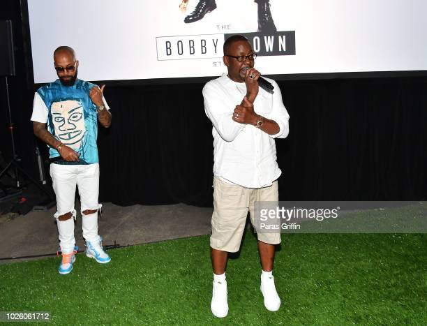 Kenny Burns and Bobby Brown onstage during The BobbyQ Atlanta Premiere Of The Bobby Brown Story at Atlanta Contemporary Arts Center on September 1...