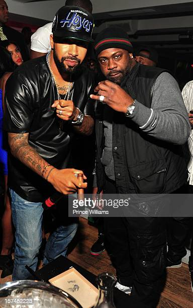 Kenny Burns and Breyon Prescott attend a party hosted by Kevin Hart at Compound on December 1 2012 in Atlanta Georgia