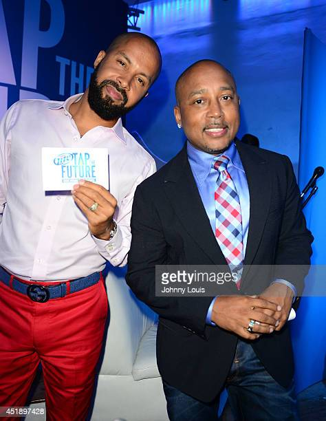 Kenny Burns and Daymond John attend Tap The Future event at Nikki Beach on July 8 2014 in Miami Beach Florida