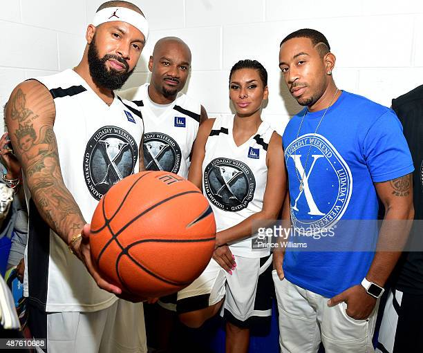 Kenny Burns Big Tigger Laura Govan and Ludacris attend Team Luda Vs Team Breezy Celebrity Basketball Game at Georgia State University on September 6...