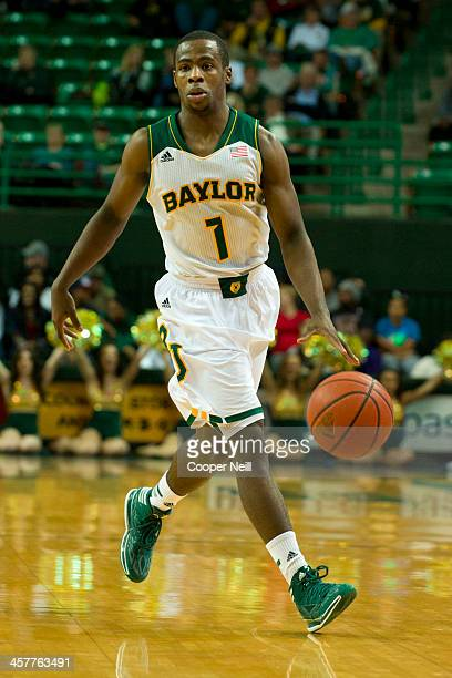 Kenny Chery of the Baylor Bears brings the ball up court against the Northwestern State Demons on December 18 2013 at the Ferrell Center in Waco Texas