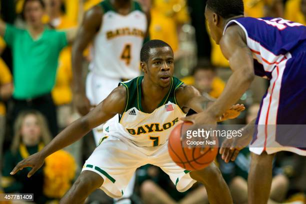 Kenny Chery of the Baylor Bears defends Jalan West of the Northwestern State Demons on December 18 2013 at the Ferrell Center in Waco Texas