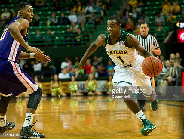 Kenny Chery of the Baylor Bears drives to the basket against the Northwestern State Demons on December 18 2013 at the Ferrell Center in Waco Texas