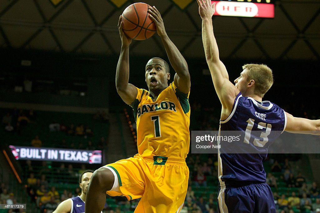 Kenny Chery #1 of the Baylor Bears drives to the basket past Christian Gore #13 of the TCU Horned Frogs on January 11, 2014 at the Ferrell Center in Waco, Texas.