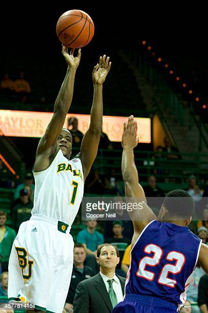 Kenny Chery of the Baylor Bears shoots the ball against the Northwestern State Demons on December 18 2013 at the Ferrell Center in Waco Texas