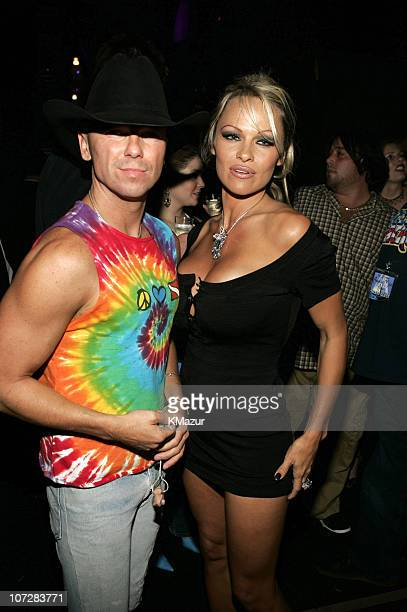 Kenny Chesney and Pamela Anderson during 32nd Annual American Music Awards Backstage and Audience at Shrine Auditorium in Los Angeles California...