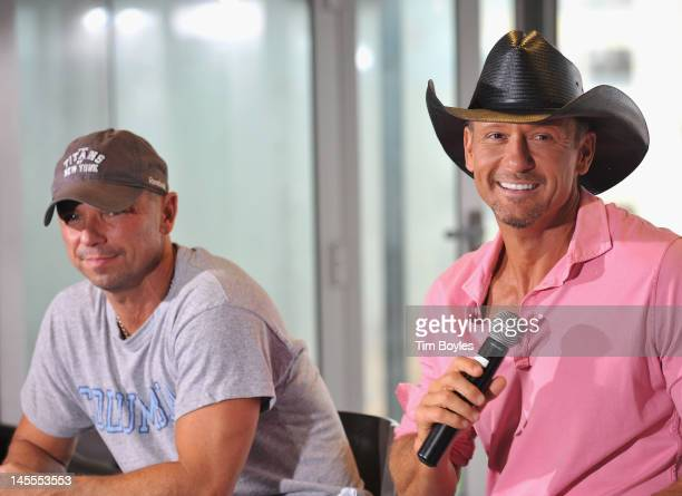 Kenny Chesney and Tim McGraw attend the 'Brothers of the Sun' Tour KickOff Press Conference at Raymond James Stadium on June 1 2012 in Tampa Florida