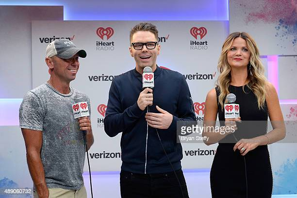 Kenny Chesney Bobby Bones and Amy attends the 2015 iHeartRadio Music Festival at MGM Grand Garden Arena on September 18 2015 in Las Vegas Nevada