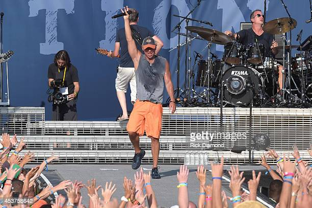 Kenny Chesney peforms live at Kenny Chesney's FloraBamaJama a free beachplay for 40000 on the Florida/Alabama line behind the historic FloraBama on...