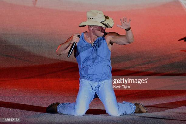 Kenny Chesney performs during Kenny Chesney and Tim McGraw 'Brothers of the Sun' Tour KickOff Concert at Raymond James Stadium on June 2 2012 in...