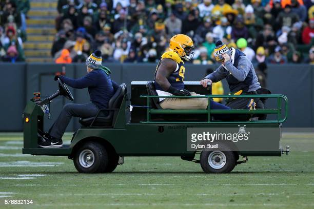 Kenny Clark of the Green Bay Packers is carted off the field after being injured in the fourth quarter against the Baltimore Ravens at Lambeau Field...