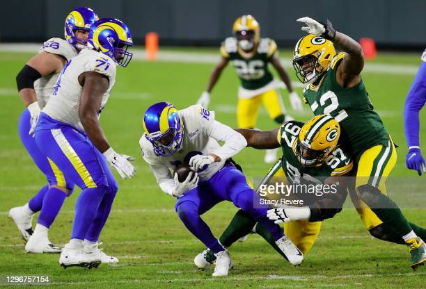 Kenny Clark of the Green Bay Packers sacks Jared Goff of the Los Angeles Rams in the third quarter during the NFC Divisional Playoff game at Lambeau...
