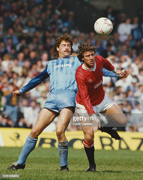 Kenny Clements of Manchester City challenges Mike Flannagan of Charlton during the Canon League Division Two match which saw City promoted to Divsion...