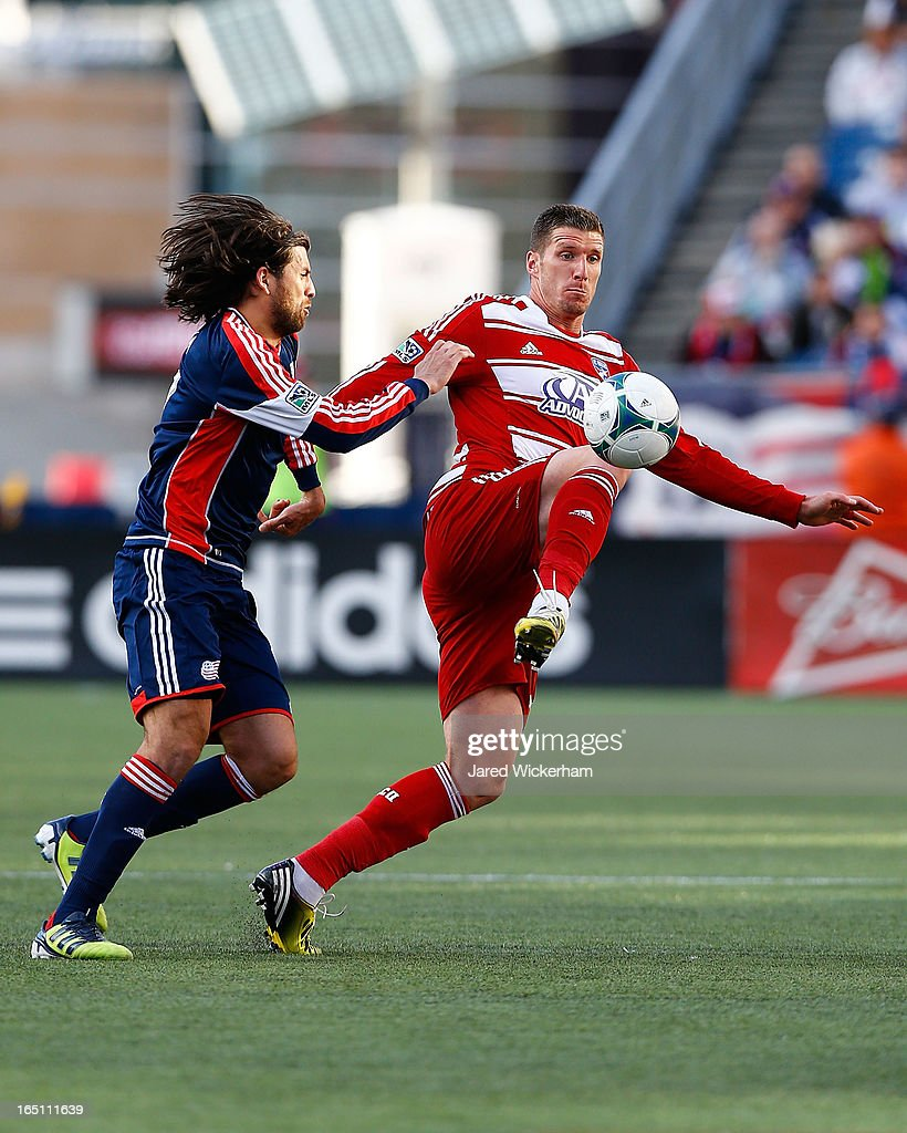 Kenny Cooper #33 of FC Dallas handles the ball in front of Kevin Alston #30 of New England Revolution during the game at Gillette Stadium on March 30, 2013 in Foxboro, Massachusetts.