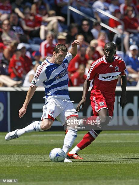 Kenny Cooper of FC Dallas kicks the ball away from Bakary Soumare of the Chicago Fire during the first half at Toyota Park on May 31 2009 in...