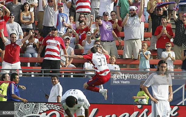 Kenny Cooper of the FC Dallas jumps over the field boards to celebrate his goal with the fans on July 27, 2008 at Pizza Hut Park in Frisco, Texas.