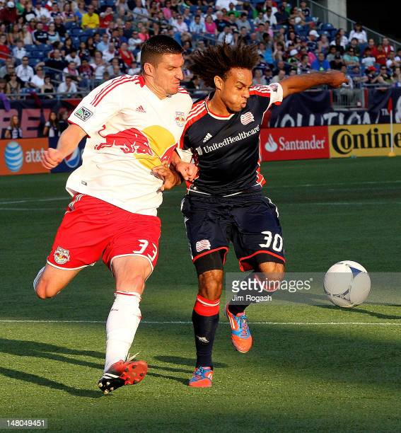 Kenny Cooper of the New York Red Bulls battles Kevin Alston of the New England Revolution for control of the ball at Gillette Stadium on July 8 2012...